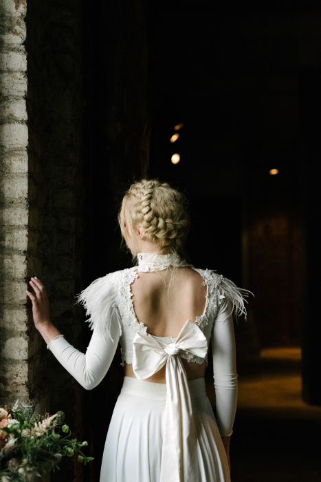blond hair bride with open back white dress with a bow in Thessaloniki