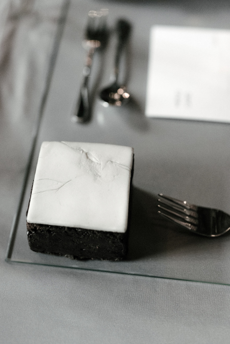 small square cake on the side of the plate as desert in Thessaloniki