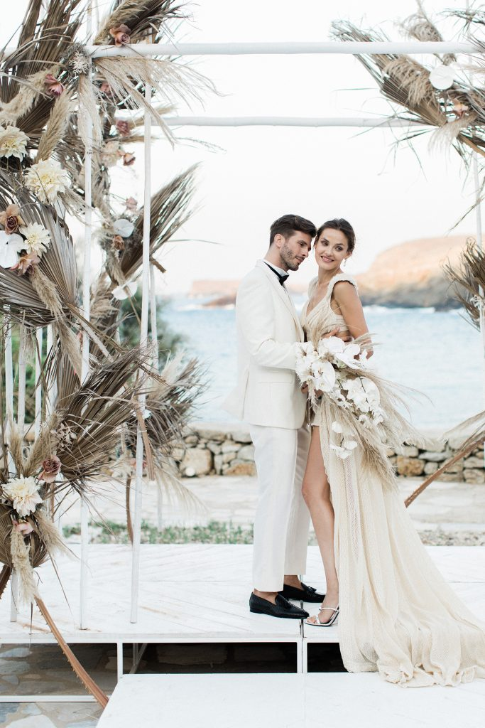 Bride and Groom under the chuppah in Bohemian wedding ceremony