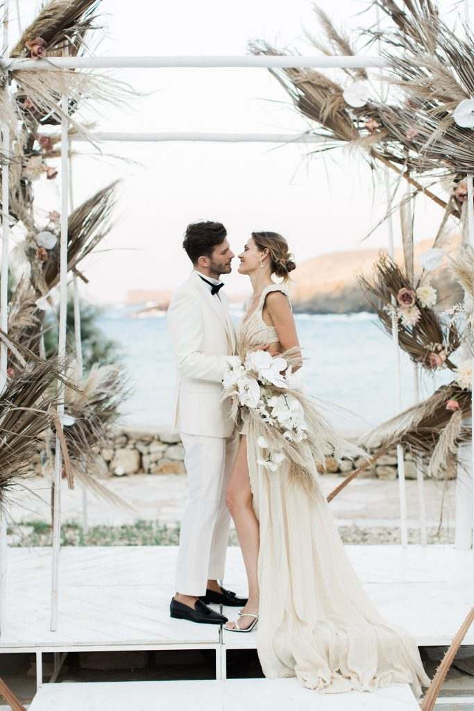 Love Story in Mykonos Bride and Groom Getting Married in Greece under the Boho Chuppah