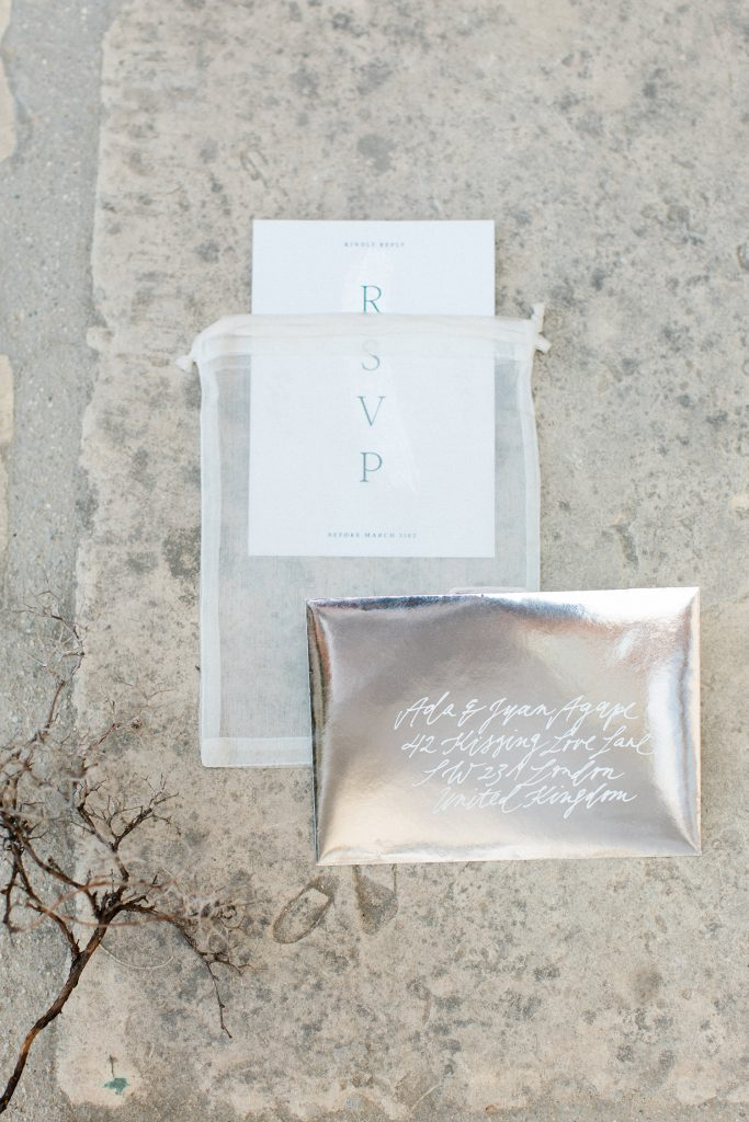 Love Story in Mykonos stationery flatlay RSVP