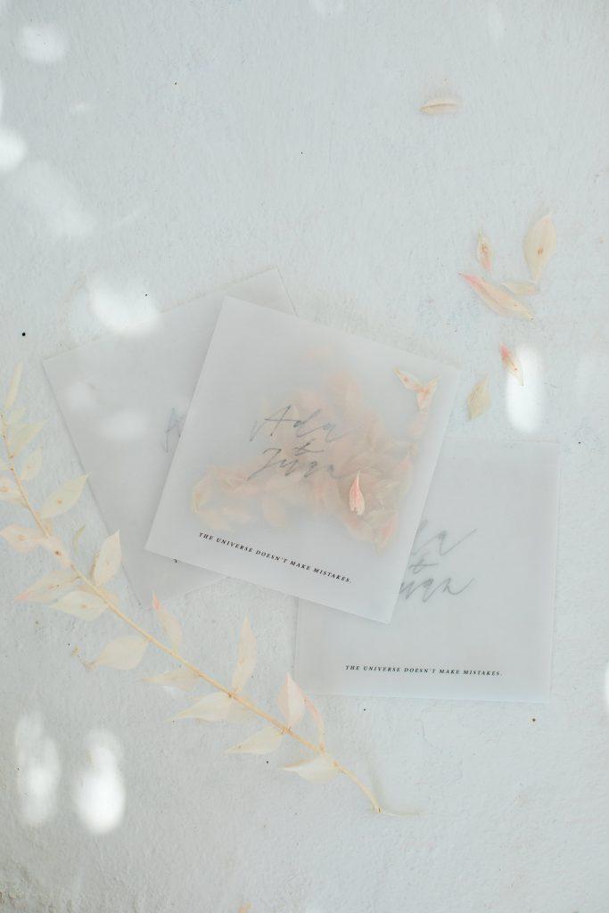 Love Story in Mykonos stationery flatlay throwing confetti