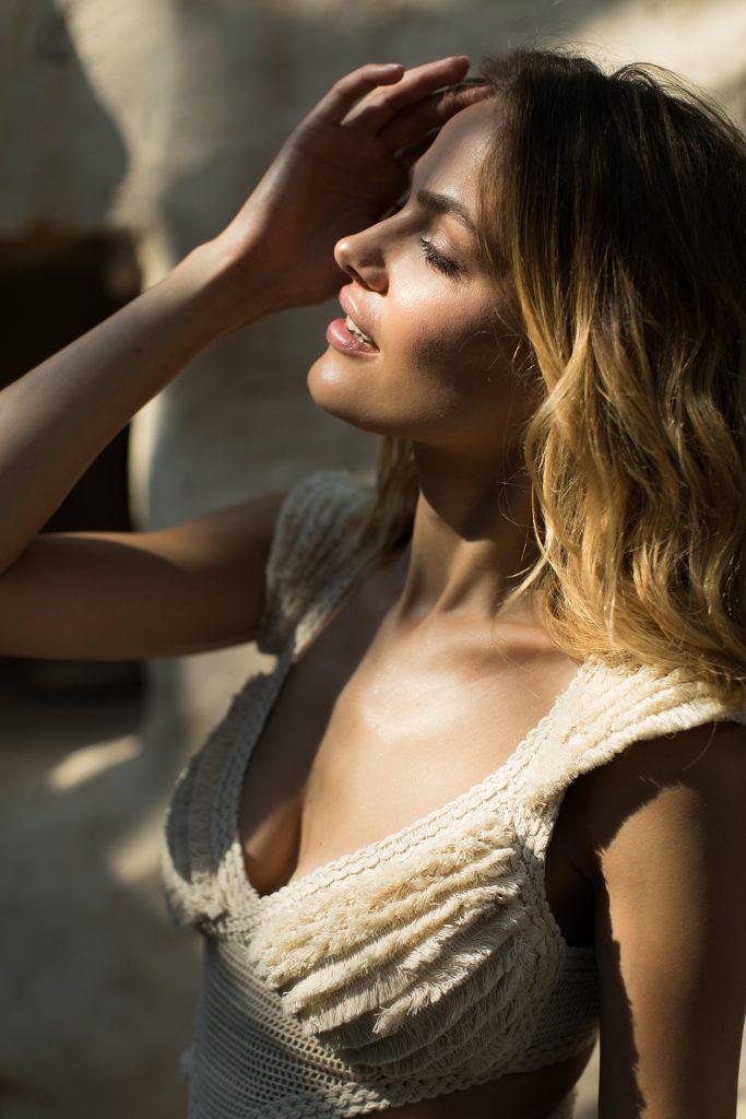 Bride Wearing Zolotas Atelier Top in the sun in Mykonos