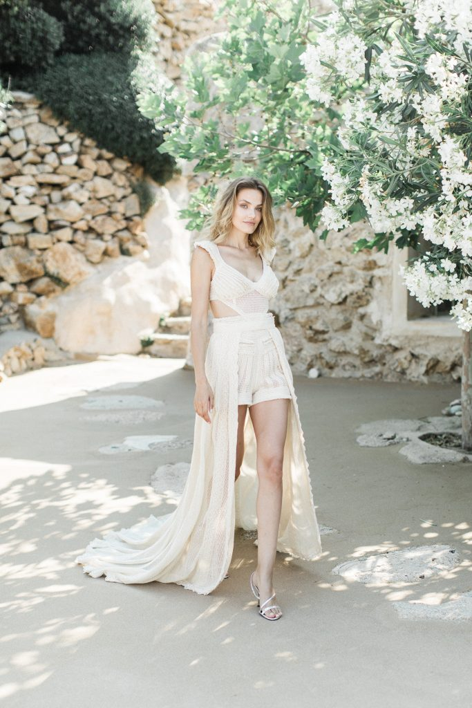 Bride walking down the aisle in the villa in shorts Love Story in Mykonos