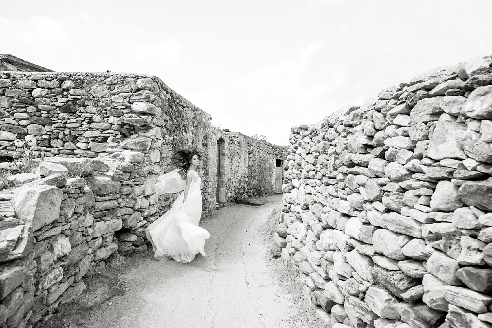 Bride running amongst the ruins on Naxos Island in Greece