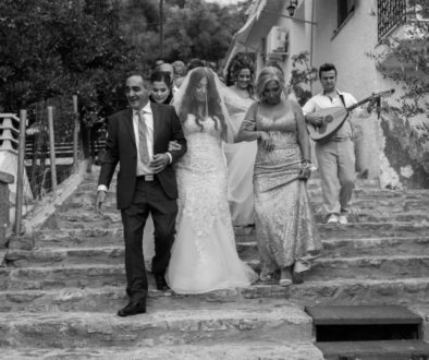 Bride walking to the church with her father and family