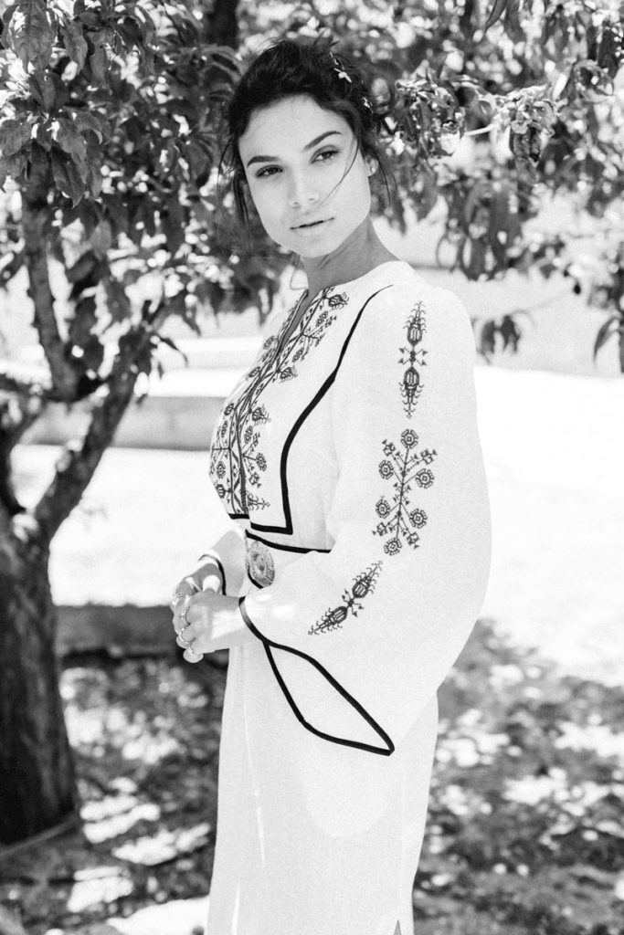 Model dressed in greek clothes for summer event