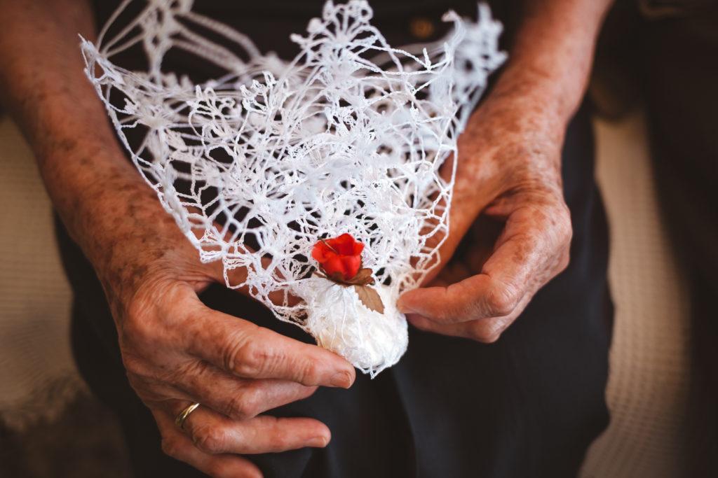 Grandmother holding a handmade crochet
