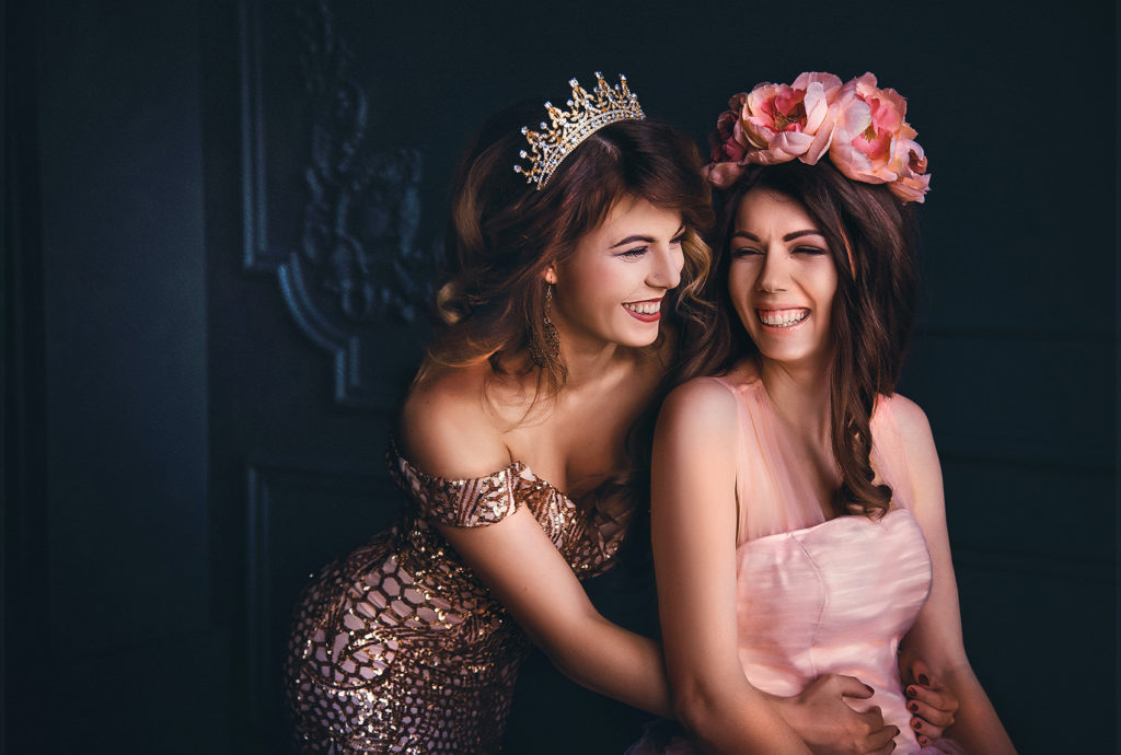 Mother of the Bride hugging her daughter in rose lace sparking dress and a crown