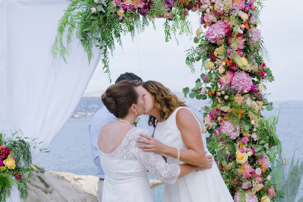 Lesbian Wedding in Greece Ceremony with colourful flowers