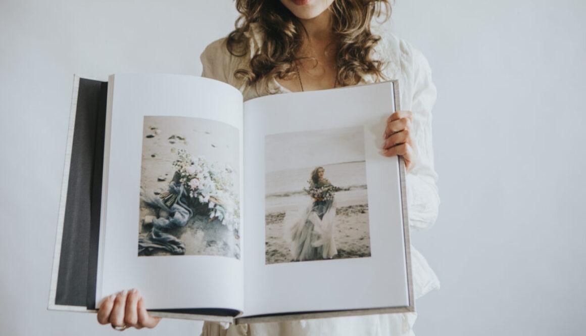 woman holding a wedding qt album heirloom edition