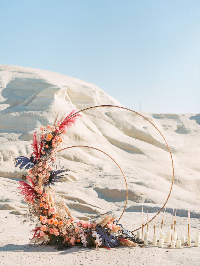 Lunar arch backdrop for Lunar Elopement Ellwed Magazine Cover Shoot in Milos