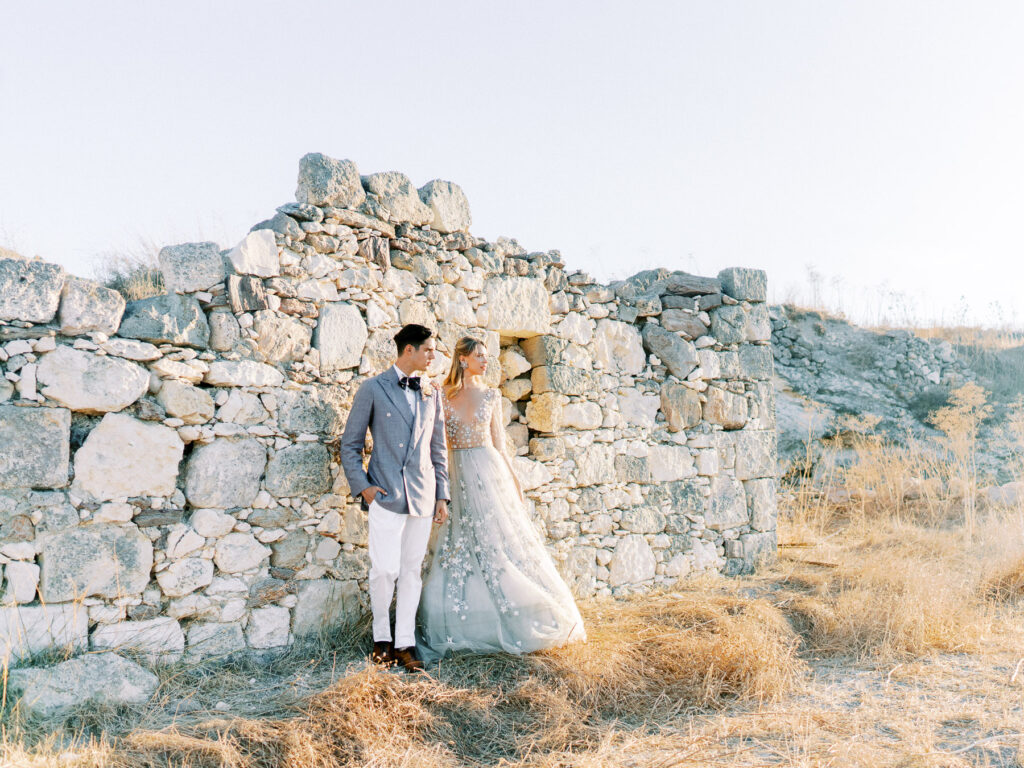 Couple at the old stone house in Milos