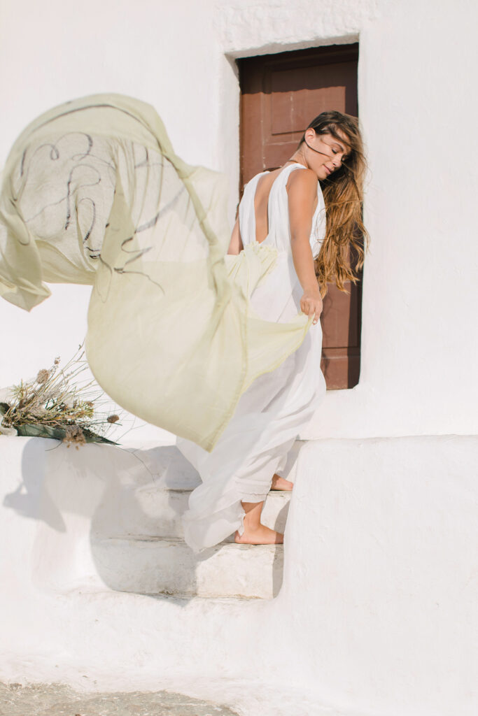 Natural Minimalist Elopement on the island of Naxos bride with windy skirt