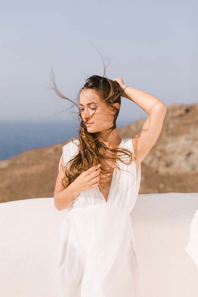 Natural Minimalist Elopement on the island of Naxos bride in the wind