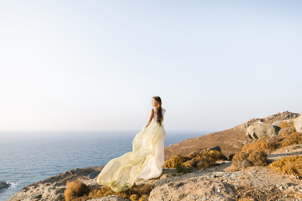 Natural Minimalist Elopement bride standing on a hill in Naxos