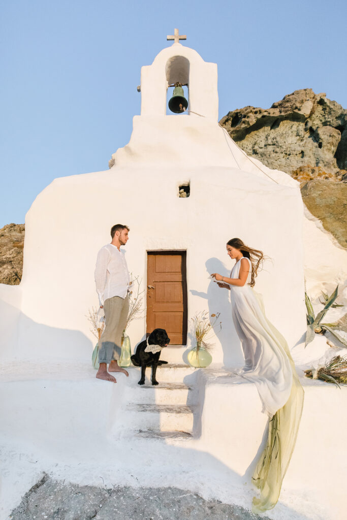 Natural Minimalist Elopement on the island of Naxos couple and the dog at the church