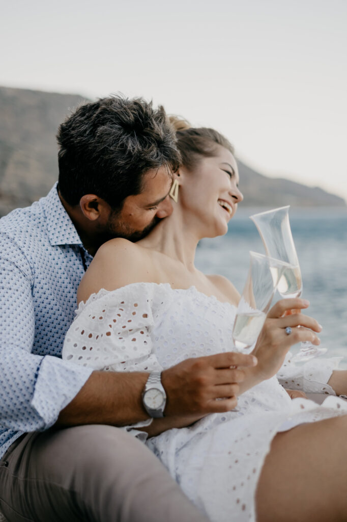Couple kissing while drinking champagne