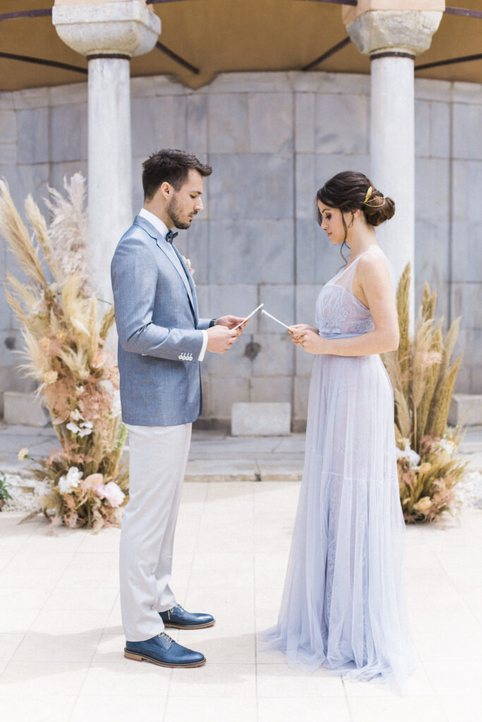 Luxury Elopement couple exchanging vows in Kavala hotel with pampas grass