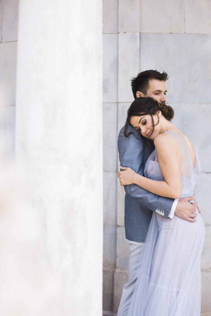 Couple hugging in dusty blue dress
