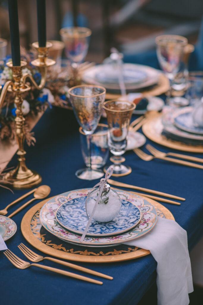 Magical Destination Christmas Wedding Table Setup art de la table with gold and blue