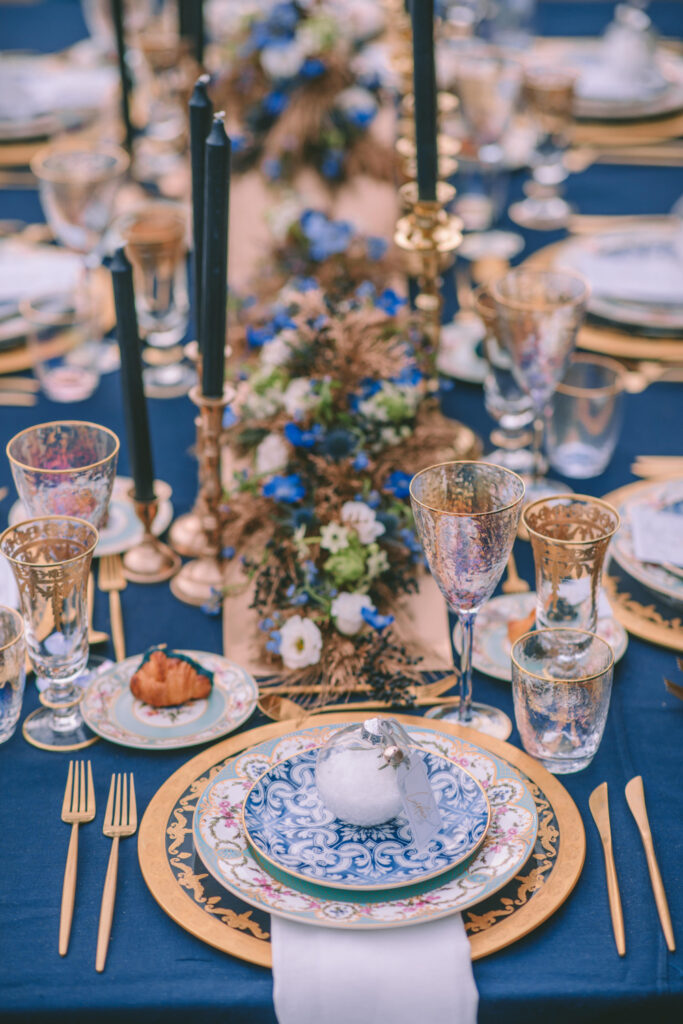 Magical Destination Christmas Wedding Table setup in gold and blue