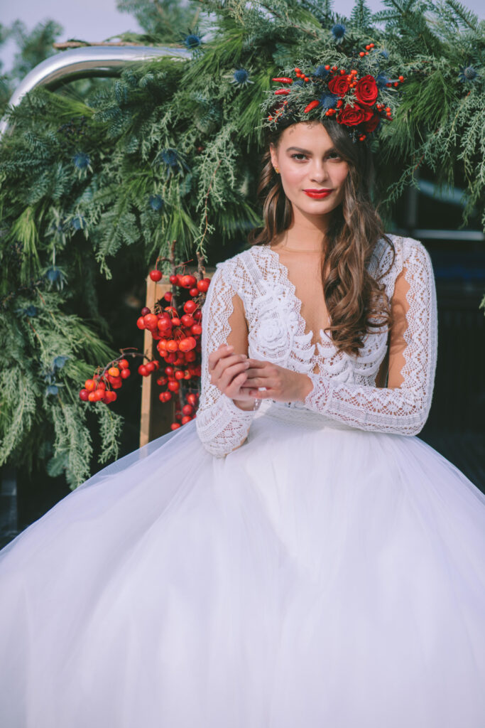 bride in white dress and long laced sleeves