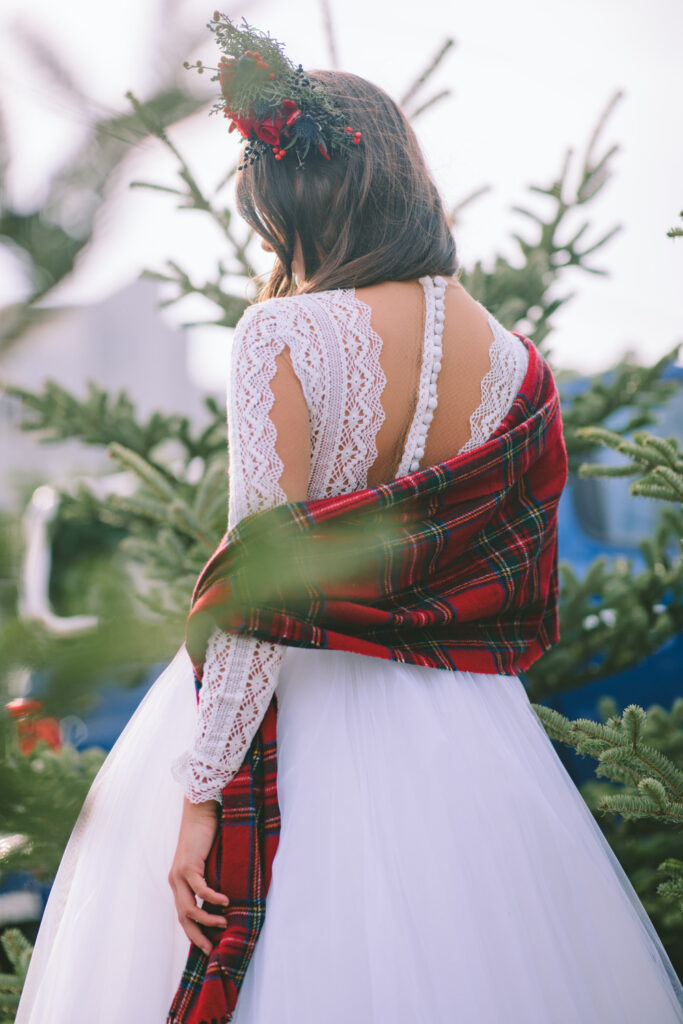 Magical Destination Christmas Bride with White dress and red shall