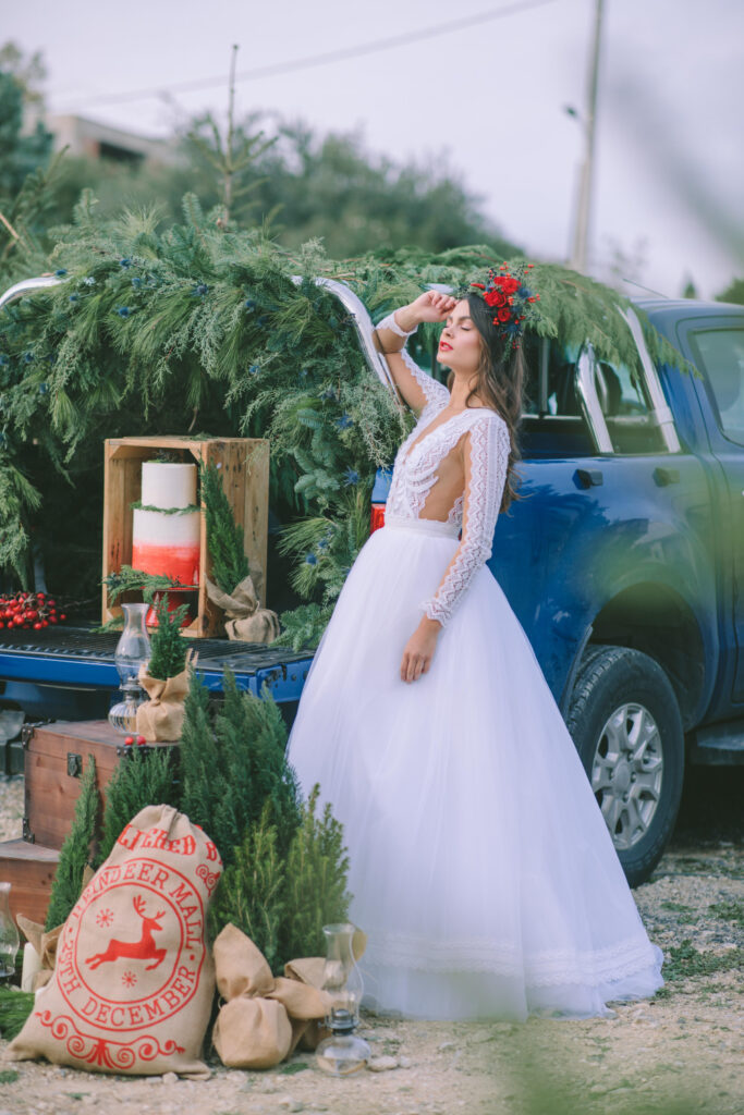 Magical Destination Christmas Wedding Inspiration with bride and a pickup truck