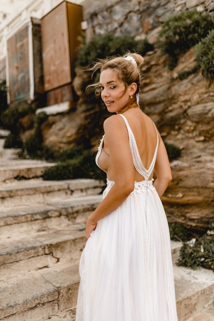 Bride climbing the stairs in Greece