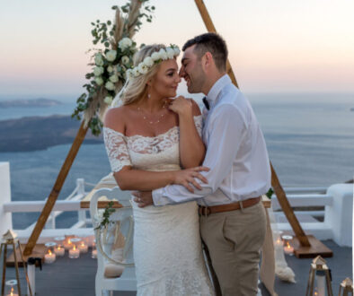 Dreamy Budget Elopement Santorini couple posing at sunset