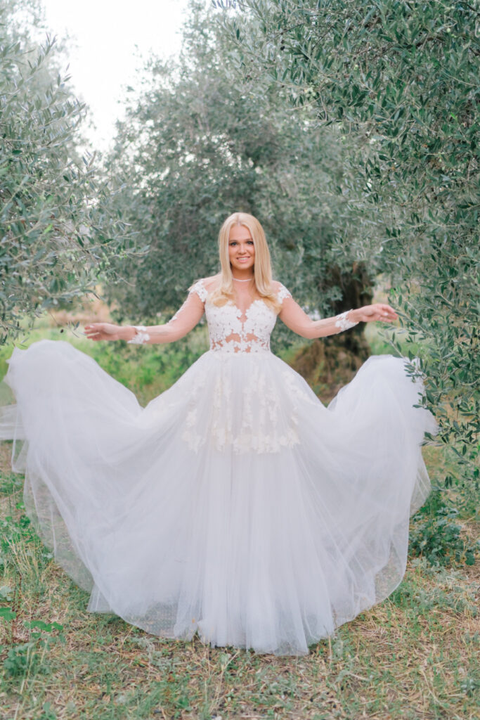 Bride and her dress in the olive grove in Crete