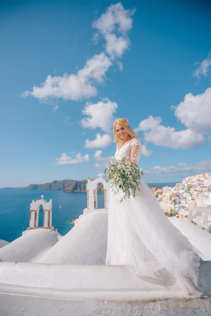 Bride standing on the white houses in Santorini