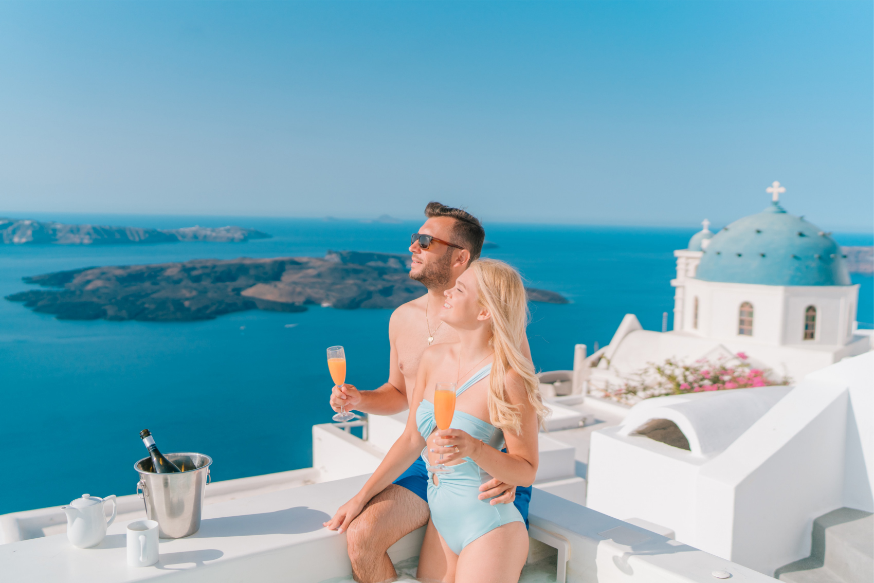 Instagram Influencer travel couple Gets Married in Greece drinking mimosas in Santorini