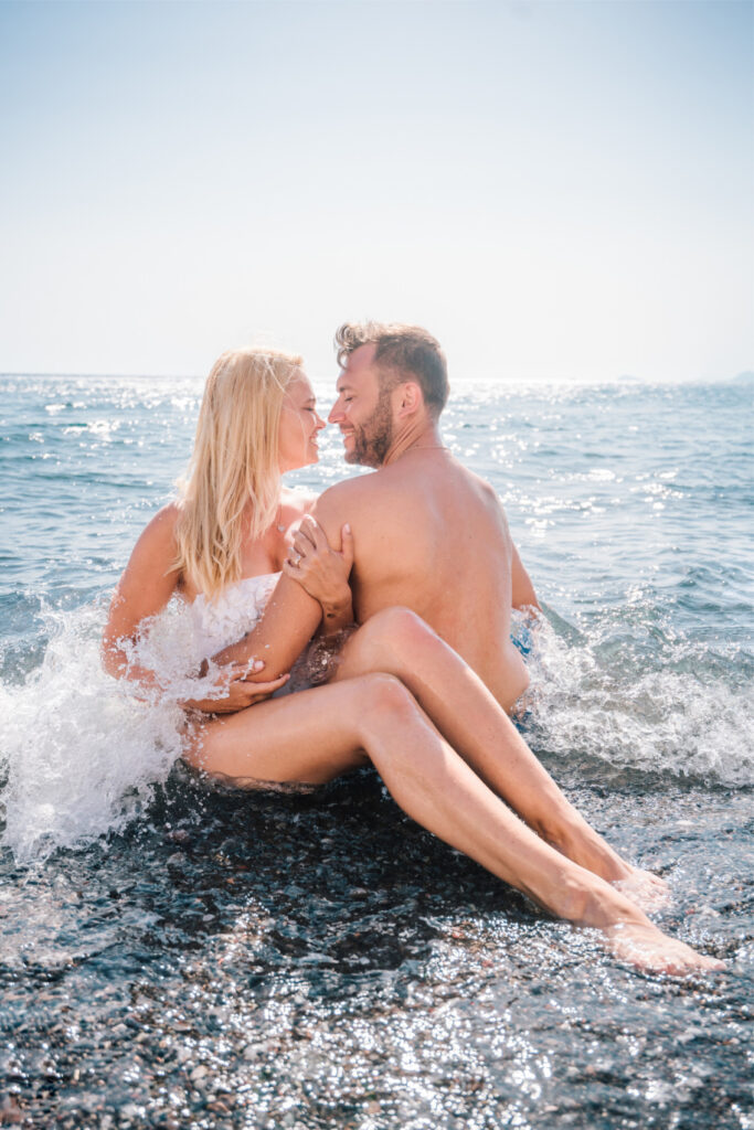 Couple kissing on the beach in the sea