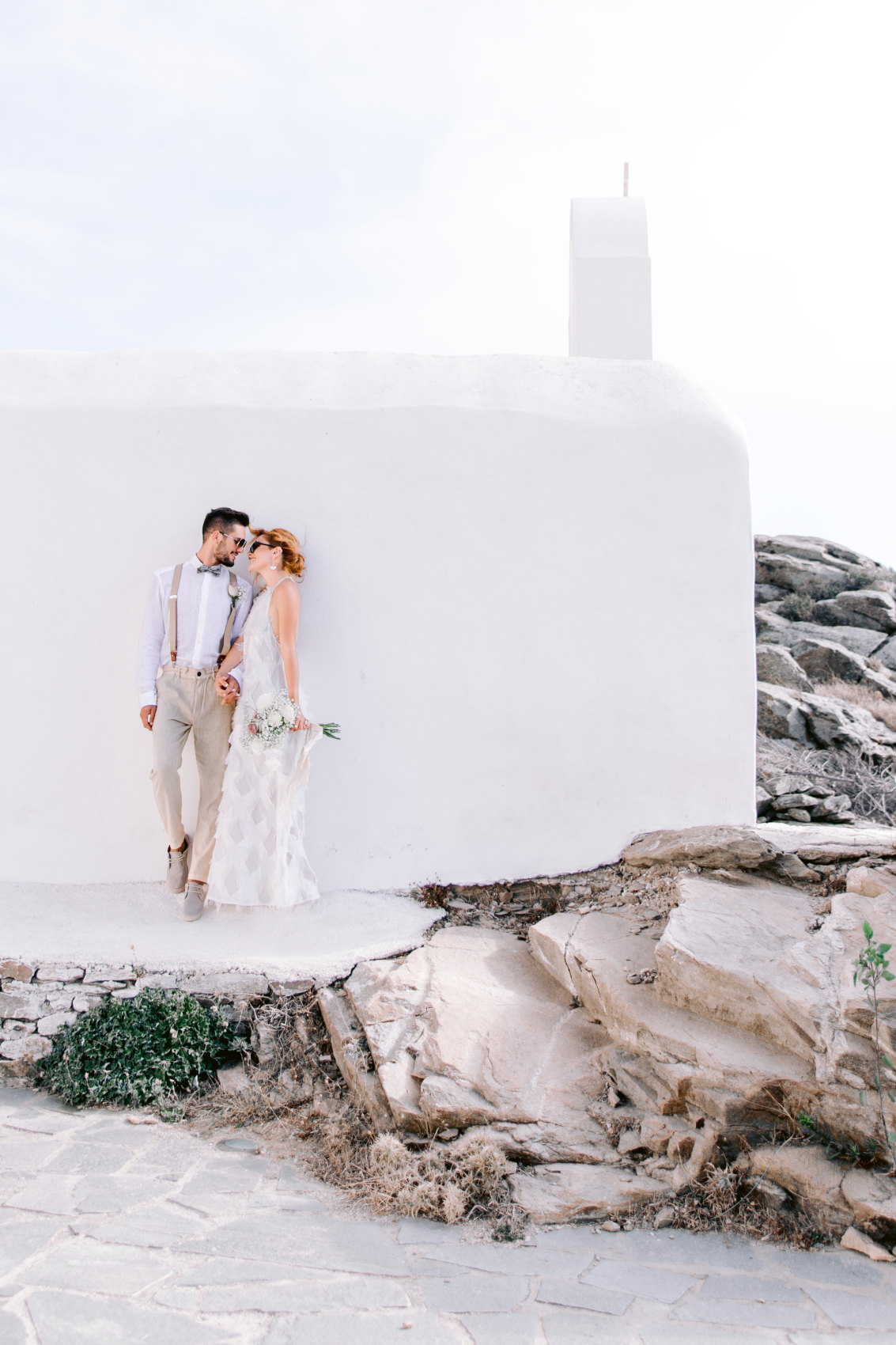 Couple standing in front of a Greek church at the Utterly Romantic Elopement