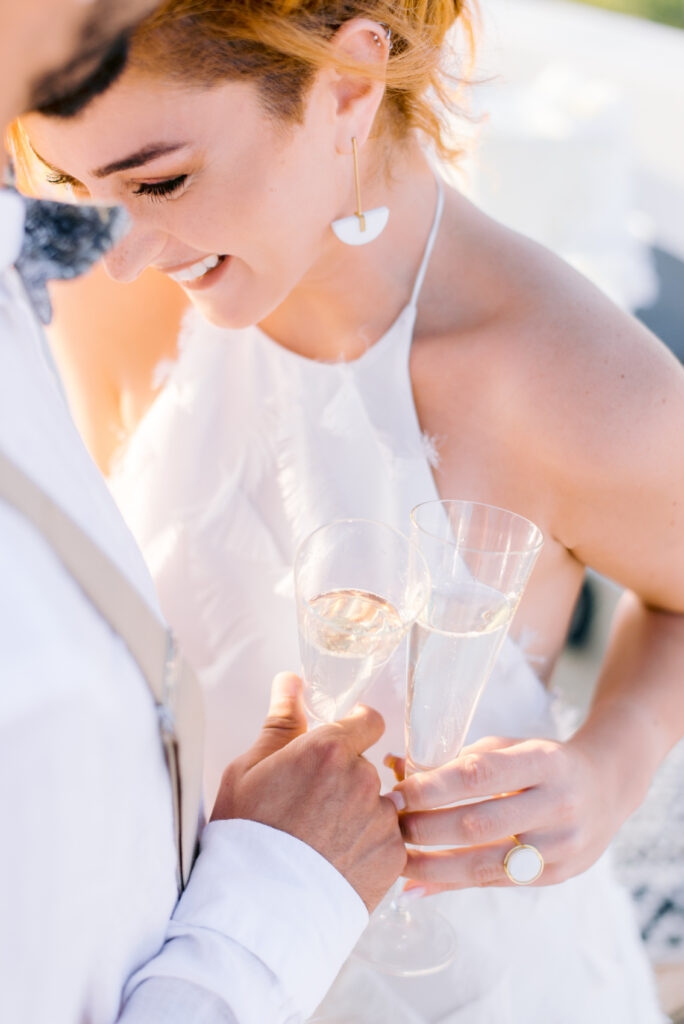 Utterly Romantic Elopement couple drinking champagne