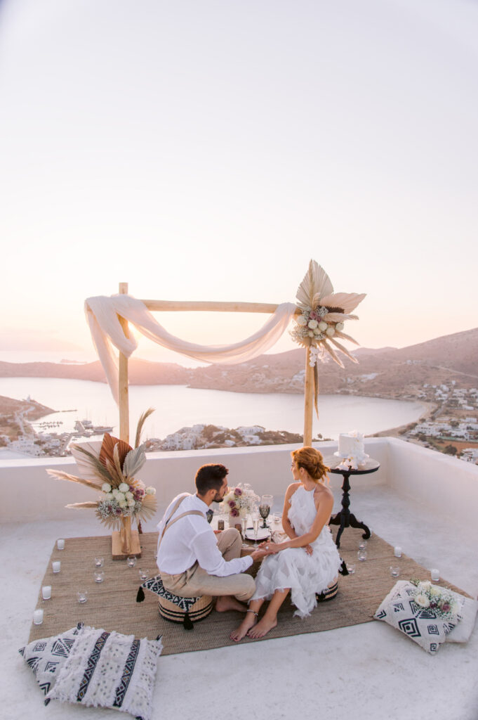 Utterly Romantic Elopement couple sitting at the ceremony setup