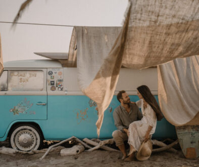 Destination Wedding in Tinos couple sitting by the beach van