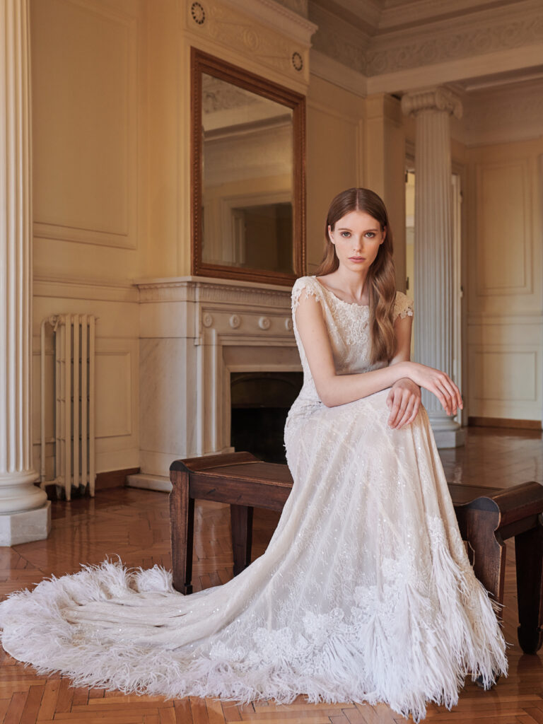 Greek Bridal Designer Bride sitting on the chair