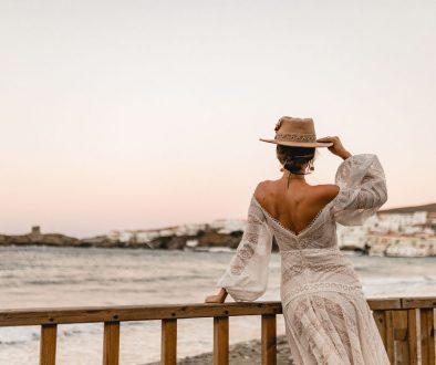 Destination Wedding Bride on the bridge with a hat