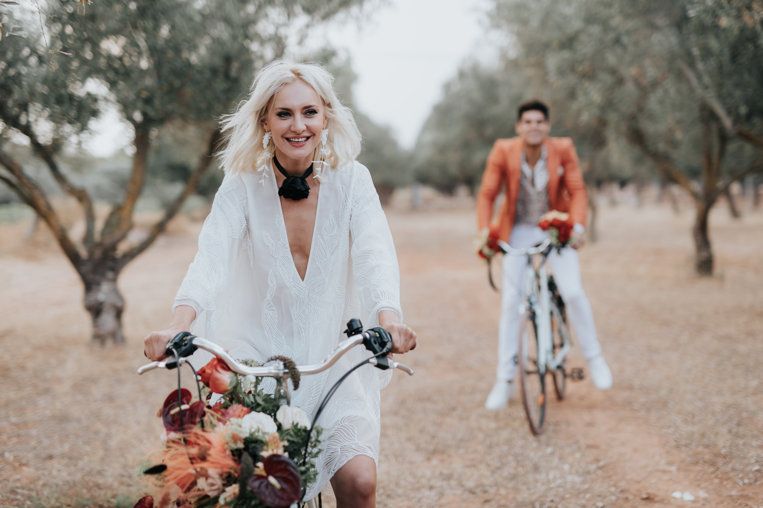 Bride and Groom driving decorated bicycles at Bohemian Rhapsody Bridal Inspiration for Alchimeia on Ellwed